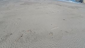 Drone Flight Over Sand Beach Towards Ocean With Descent And Movement stock footage