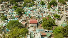 Manila North Cemetery aerial view. The northern cemetery in Manila with many graves and crypts in the city center aerial view. Travel concept stock footage