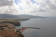 Northern city view of Sorrento, Italy from a nearby cliff. Cliff side view of the Sorrento, Italy and Naples Bay from the northern side road stop Stock Photography