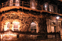 The Northern Club building covered in Virginia Creeper at night, Stock Photography