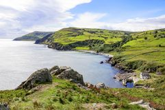 Northern coast of County Antrim, Northern Ireland, UK. Northern coast, a bay and a small harbor in County Antrim, Northern Ireland, UK, The view from Torr Head royalty free stock photography