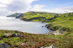 Northern coast of County Antrim, Northern Ireland, UK. Northern coast, a bay and a small harbor in County Antrim, Northern Ireland, UK, The view from Torr Head stock photos