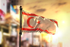 Northern Cyprus Flag Against City Blurred Background At Sunrise Stock Photo
