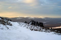 Northern dawn in winter mountains royalty free stock photo