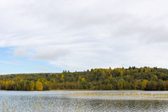Northern forest lake in autumn Stock Photo