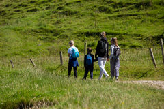 Northern Ireland  landscape, hiking family on pathway, next to a fence Royalty Free Stock Image