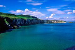 Northern Ireland, panoramic view of the gorgeous Antrim coastline on a wonderful summer day. Landscape of Northern Ireland, coastline and cliff, green hills and royalty free stock photos