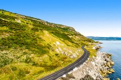 Causeway Coastal Route in Northern Ireland, UK. Northern Ireland, UK. Causeway Coastal Route a.k.a Antrim Coast Road. One of the most scenic coastal roads in stock photos