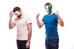 Northern Ireland vs Poland. Football fans of national teams demonstrate emotions: Northern Ireland win, Poland lose. Royalty Free Stock Image