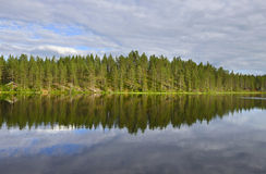 Northern landscape with a lake. Reflection Royalty Free Stock Photo