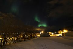 Northern Light  above Gravdal's houses Royalty Free Stock Photography