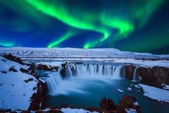 Northern Light, Aurora borealis at Godafoss waterfall in winter, Iceland
