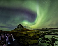 Northern Light Aurora borealis at Kirkjufell Iceland with fully. Start in the sky Stock Photo