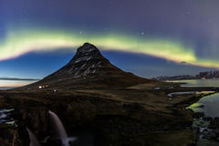 Northern Light Aurora borealis at Kirkjufell Iceland with fully. Start in the sky Royalty Free Stock Photo