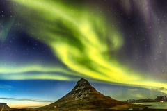 Northern Light Aurora borealis at Kirkjufell Iceland with fully. Start in the sky Royalty Free Stock Images