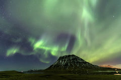 Northern Light Aurora borealis at Kirkjufell Iceland with fully. Start in the sky Royalty Free Stock Photos