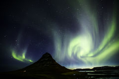 Northern Light Aurora borealis at Kirkjufell Iceland with fully. Start in the sky Stock Images