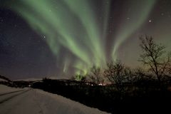 Northern Light Aurora. Northern Light, aurora over road with snow. Photo taken at Tromso, Norway Stock Images
