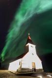 The Northern Light aurora over at Vik Church Stock Photos