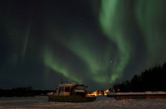 Northern light dancing on lake Royalty Free Stock Photography