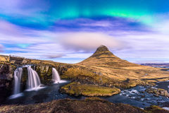 Northern Light in Kirkjufell Iceland. Northern Light over Kirkjufell, Grundarfjordur town, West Iceland with small dark cloud cover the mountain Stock Image