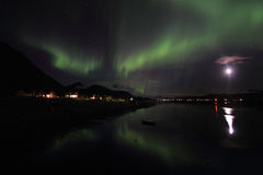 Northern Light  mirroring in the fjord Royalty Free Stock Image