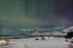 Northern Light on a Haukland  bay Stock Images