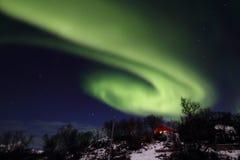 Northern Light whirlpool above Hagskaret hills Royalty Free Stock Photo