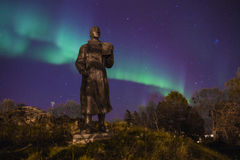 Northern light (aurora borealis) behind a statue Royalty Free Stock Photo