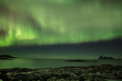 Northern light (aurora borealis) in a fjord Stock Photos
