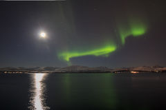 Northern light (aurora borealis) on a full moon night Stock Image