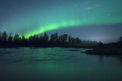 Northern lightrs over the rive royalty free stock photography