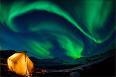 Northern lights. Camping in the north with the northern lights overhead (Aurora Borealis Royalty Free Stock Photography