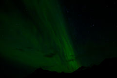 Northern Lights. Taken in Iceland near Akureyri the Northern Lights, or Aurora Borealis, is visible extending up over the mountain with the stars also visible royalty free stock images