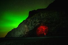 Northern Lights above black sand beach in Vik royalty free stock images