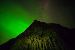Northern Lights above black sand beach in Vik stock photos