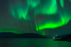 Northern lights above the fjord Stock Image