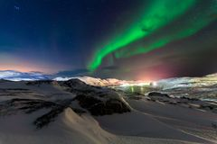 Northern lights above the fjord in Norway.  Royalty Free Stock Image