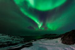 Northern lights above the fjord in Norway.  Stock Photo