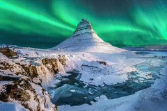 Northern lights appear over Mount Kirkjufel Royalty Free Stock Images