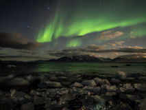 Northern Lights (Aurora Borealis) above the Arctic fjord Stock Image