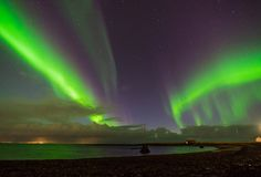 Northern lights Aurora Borealis above landscape in Iceland Royalty Free Stock Photography