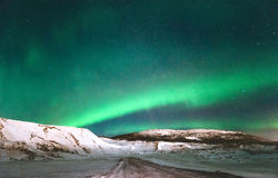 Northern lights Aurora borealis above Mountains Royalty Free Stock Images