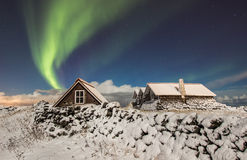 Northern Lights. Aurora Borealis or Northern lights above old cottage just outside city of reykjavik, iceland Stock Photos