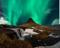 Northern lights aurora borealis appear over Mount Kirkjufell in Iceland. stock images