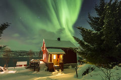 Northern lights Aurora Borealis in the night above a typically a Royalty Free Stock Photos