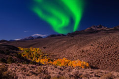 Northern lights aurora borealis in the night sky over beautiful lake landscape Royalty Free Stock Images