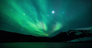 Northern lights (aurora borealis) over a glacier lake in Iceland
