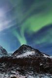 Northern lights (Aurora borealis) over Mountain Stock Photography
