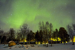 Northern Lights (Aurora borealis) over winterly landscape stock photo